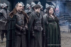 The entire fifth season of the Emmy®-, Golden Globe®- and Peabody®-winning series will be simulcast to HBO branded networks and broadcast partners across the world, including in the Caribbean, creating a global television event week after week throughout the season's 10-episode run. (Michael McElhatton as Roose Bolton, Iwan Rheon as Ramsay Bolton and Elizabeth Webster as Walda Frey – photo Helen Sloan/HBO)
