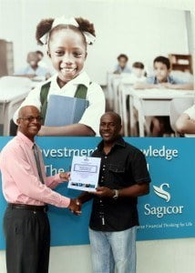 Sagicor Advisor Roderick Nurse presented Anthony Lynch with his Hilton Barbados Resort prize of day-passes for four and lunch.