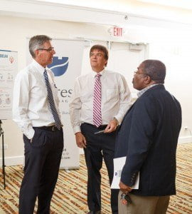 (From left) Rene Delmas, Fortress' pension director; Michael Parris, director, Prism Services; and John Williams of JDW Inc. Consulting Services  talk pensions during the Fortress SHRM Meet and Greet.