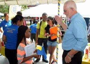 New General Manager at Brydens Insurance, Richard Ince chats with a student at the career fair at the University of the West Indies recently.