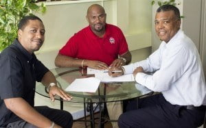 Charles Walcott (left) and Dexter Percil of Banks (Barbados) Breweries Limited, along with Michael Muirhead, Chief Executive Officer of the West Indies Cricket Board, after the 'Beer of Barbados' renewed its partnership with the WICB for the upcoming Home Series against England.