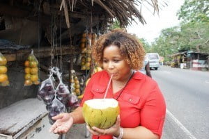 Shereese stops to drink a coconut on her way to the Grand Palladium Resort in Hanover, Jamaica