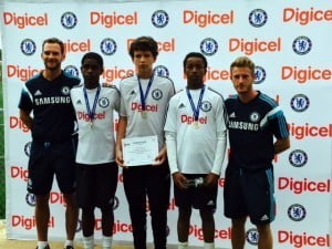 The winners of the Digicel Kickstart Clinics held in Bermuda, from left to right: Chelsea FC Foundation Coach, David Monk, 15 year old Enyche Zuill, 14 year old Andrew Kempe and 15 year old Omar Wilson and Chelsea FC Foundation Coach, Max Fouracre