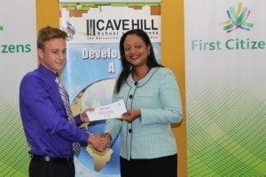 Kaye-Ann Brathwaite presenting the cheque of BDS$5,000.00 to winner, Adam Gibbs