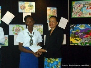 Taja Mann from St Michael's School receives her $600.00 Art Hub voucher from Dr Karen Springer, she earned 3rd place in the poster category for Secondary Schoolchildren (Taja is Tariq's older sister – they are the children of Barbadian artist Denzil Mann)