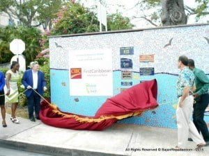 (L to R) Vivian Anne Gittens, Chair and Patron of the Future Centre Trust; Rik Parkhill, CEO of CIBC FirstCaribbean; Dr Justin Robinson, Chair of the National Insurance Scheme and David Spieler of Earthworks Potteries drawing aside the velcroed curtain from the official plaques commemorating the event.