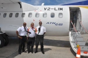 Antigua's Robin Yearwood, Min. of Public Utilities, Civil Aviation & Transportation with LIAT Chief Executive Officer David Evans in the flight deck of LIAT's latest ATR aircraft