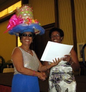 Pansy Griffith receiving her prize for Most Unique Hat from Mrs Bushell