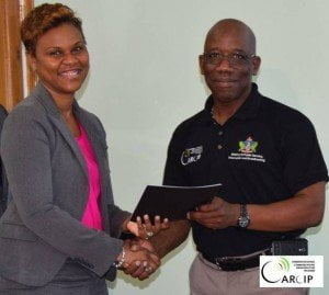 Left to right: Mrs. Siobhan James-Alexander, Country Manager, Digicel and Mr. Christopher Roberts, Project Coordinator, CARCIP, at the formal signing of the memorandum of understanding for Digicel to become a peering member of the Saint Lucia Internet Exchange on April 2, 2015. Courtesy: Caribbean Regional Communications Infrastructure Program St Lucia