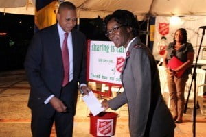 """It is a tribute to the generosity of Barbadians in these trying economic times. Even though we did not reach our target of seven hundred thousand dollars, to have raised six hundred and fifty thousand dollars is certainly a successful effort."" Scotiabank (Barbados) CEO David Noel seen to start the kettle ""boiling."""