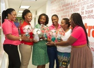 Digicel also pampered its 21 mothers on staff at its Warrens Head Office. Here HR Administrative Assistant Gina Coulthurst (right) getting a glimpse of the special treats with some of the mothers (from left to right) – Karen Bridgeman, Yasmin Millington, Andrea Worrell, Susan Griffith and Larysa Gittens.