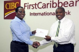 CIBC FirstCaribbean contributed to the staging of a fundraiser for the Cystic Fibrosis Foundation of Barbados. Here Michelle Whitelaw, Director, Retail Banking Channels (left) presents President Michael Turton, with a financial contribution.