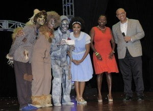 (From right) Mark St. Hill and Michelle Whitelaw of CIBC FirstCaribbean pose with cast members of The Wiz. The production was staged recently to sold-out audiences by the developmental performing arts programme, Operation Triple Threat.