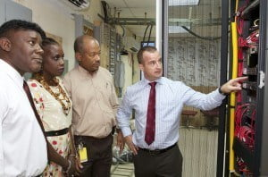 Digicel Business Solutions Director (Eastern Caribbean), Martin Keogh, explains to Acting QEH CEO, Louise Bobb, and QEH IT Manager, Cameron Connolly, how the Avaya-powered Unified Communication platform will benefit the medical and administrative staff while Digicel Barbados Strategic Business Development Director, Oliver Haynes, looks on