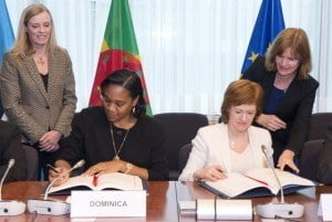 (Left) Dominica's Minister of Foreign Affairs, Ms. Francine Baron, at right signing with her is Ms. Zanda Kalnina-Likasevica, State Secretary, Latvian Ministry of Foreign Affairs
