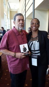 Dr. Ralph Gonsalves (L), Prime Minister of St. Vincent and The Grenadines, receives copy of Language, Culture, and Identity in St. Martin from its author, Dr. Rhoda Arrindell—following informal meeting at the conference hall, Hyatt Regency, Trinidad and Tobago (© RA photo)