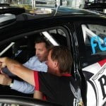 Managing Director of Columbus Barbados getting a quick lesson on the WRC07 rally car from rally icon Paul the Surfer Bourne