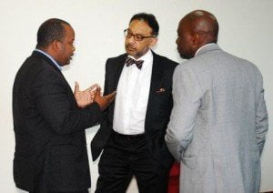 Minister Bharath listens attentively to Daren Lee Sing (l), while Andy Johnson (r) makes sure no uncomfortable questions are asked observes the interaction