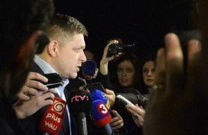 Slovakia's Prime Minister and then-presidential candidate Robert Fico (L) arrives at a party election centre to observe the ongoing election results in Bratislava on 29th March 2014. (REUTERS/Radovan Stoklasa)