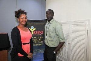 "Tricia Greaux (left) and Stephan Joseph (right) participants at the 14th Edition of ""Vybzing"" Youth Forum"