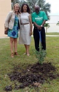 "Left to right: USAID Natural Resource Officer and deputy chairman of the ""Green Team,"" Christina Cairns, wife of U.S. Ambassador to Barbados, the Eastern Caribbean, and the OECS, Mrs. Lucille Palmer, and co-chair of the ""Green Team,"" Jeffrey Griffith plant a local cherry tree at the U.S. Embassy in honor of Earth Day."