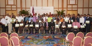 Minister Bharath (front row center) with Mr. Norris Herbert, Permanent Secretary (Ag.) to his left and Ms. Donna Marshal-Elias to his right surrounded by the New Dealers