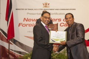 Minister Bharath presents Mr. David Ramsingh of Imexpo Group Limited with his Certificate