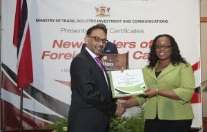 A smiling female dealer receives her Certificate from Minister Bharath