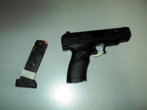 (FILE IMAGE - DEMO ONLY) On 24th May 2015, members of the Drug Squad executed a search warrant at the residence of Jean-Baptiste who is currently on suspension from duty, and the firearm and ammunition were discovered and seized.
