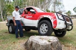 """June"" champion Leslie Alleyne giving a few pointers on handling the Shell Rimula/Shell Spirax/Simpson Motors Isuzu D-Max to Sol Barbados Limited, Sales Executive - Lubricants, Aisha Lockhart."