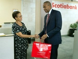 Scotiabank Managing Director David Noel, thanks customer Cecilia Mark for her business.