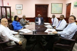 CIC representatives meet with PM Harris (at head of table) and other government officials. (SKNIS Photo)