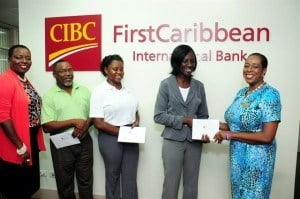 Paige Bryan, Manager, Retail Banking Channels makes presentations to (from second right) Mavis King, the Whim Outreach Programme; Carla Alleyne, Duke of Edinburgh's International Award Barbados; and Caswill Payne, Mount Wilton Eco-Tourism Association while Michelle Whitelaw, Director, Retail Banking Channels looks on.