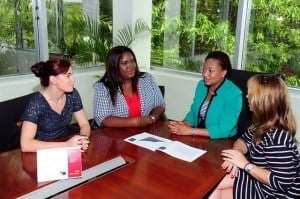 Senior Trust Officer, Wealth Management, CIBC First Caribbean, Nicole Weekes (second right) hears about various initiatives for young children from (left) Natasha Heaselgrave, More4Kids Barbados;  Tonya Sealy,  St Jude's Primary School PTA secretary; and Gabrielle Logan, More4Kids Barbados
