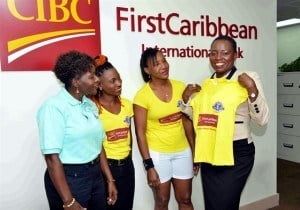 Michelle Whitelaw, CIBC FirstCaribbean's Director, Retail Banking Channels (right) clearly needs a bigger t-shirt, the executive is seeking to show support for the Touch of Class Women's Road Tennis Tournament under the watchful eye of (left) Juliet Worrell, PRO, Barbados Road Tennis Association and two of the players.