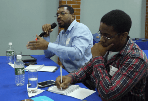 Executive Director of the Dominica National Telecommunications Regulatory Commission Craig Nesty, left, asks questions during an open session at ARIN on the Road Dominica, Fort Young Hotel, Roseau, June 18. Photo: Gerard Best