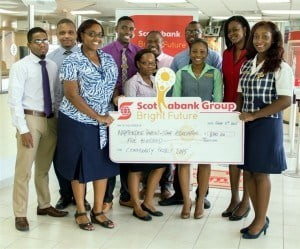 Employees from the Black Rock branch present their donation to Winsome Thomas of the Nightengale Parent-Staff Association (third from left)