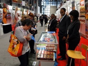 Visitors viewing Charles Candy product display
