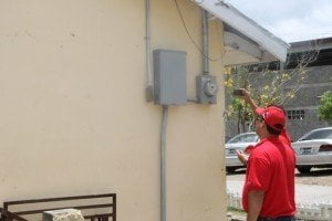 Members of the Venezuelan delegation assessing the electricity supply at the Charlestown Secondary School
