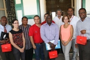 General Manager POV St. Kitts Nevis Ltd. Maria Andreina Colmenores (front row, second from right) and other members of the Venezuelan delegation led by resident Venezuelan Ambassador to St. Kitts and Nevis His Excellency Ròmulo Henriquez Gonzàlez  (back row, third from right) with Acting Premier of Nevis Hon Mark Brantley (extreme right), Minister responsible for Renewable Energy Hon. Alexis Jeffers ( front row, second from left), Acting General Manager of the Nevis Electricity Company Ltd. Jervan Swanston (extreme left) at the Nevis Island Administration office, Bath Hotel