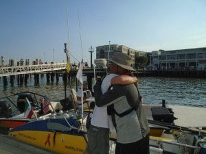 Victor Mooney (49) of Queens, New York and a worker at the Charleston Maritime Center embrace each other on the oarsmen arrival. Mr. Mooney is nearing the completion of a 5,000 mile transatlantic row to encourage voluntary HIV testing.