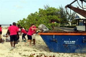 3. Digicel's CEO, Johnny Ingle (front) and other staff members as they took part in a beach clean-up recently to help rid the Welches Beach in Christ Church of some of the Sargassum seaweed overtaking local beaches.