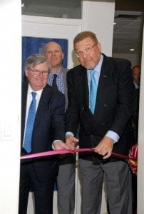 Chief Executive Officer of CIBC FirstCaribbean International Bank, Rik Parkhill, and Angel Bermudez, Minister of Finance of Aruba, cut the ribbon to declare the new Aruba office open for business.