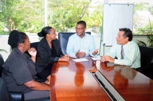 (From left) Vickie Durant and Dr. Diane Brathwaite of the Barbados Diabetes Foundation and Edmond Bradshaw of the Barbados Red Cross (right) discuss the work of their charities with CIBC FirstCaribbean's Barrington Watson, Director, Corporate Investment Banking.