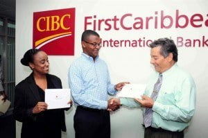 (Right) Edmond Bradshaw of the Barbados Red Cross receives a contribution from CIBC FirstCaribbean's Barrington Watson for the support of its programmes while Dr. Diane Brathwaite of the Barbados Diabetes Foundation looks on.