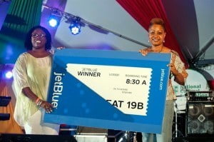 Door prize winner of the Pan Fusion event tagged 'Sweet Pandemonium' will be jetting off to the US compliments Representative for JetBlue, Ms. Sophia Catwell presenting the travel certificate to Helen Zamor, collecting on behalf of Pamela Ifill.