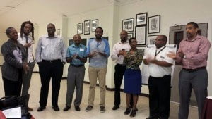 (From left to right) Ms. Maragret Leon, Mr. Larry Mayers, Mr. Andre Griffith, Mr. Roger Callender, Mr. Edwin Workman, Mr. Cleverston Miller, Ms. Cheldeane Miller, Mr. Franklyn Jackman, Mr. Philip Lewis