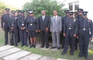 Premier Amory (fifth from right) with PM Harris and police officers from the Nevis Division. (File photo)