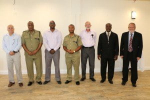 Jose Rosa (left) Vice President of Chamber of Industry and Commerce, Stafford Liburd (2nd left) Acting                                         Commissioner of Police, Damion Hobson (3rd left) President of Chamber of Industry and Commerce, Dave King                             (right) UK Consultant, Andre Mitchell (2nd right) Superintendent,  Emile Ferdinand QWF( 3rd left) Partner at                                 Kelsick Wilkin and Ferdinand and Vaughan Henderson (center) Assistant Commissioner of Police