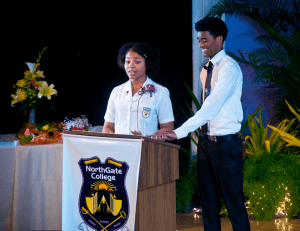 NorthGate College Head Girl Rebekka Wooding, left, and Andrew Dookhoo, valedictorians from sixth and fifth form respectively, jointly deliver their Valedictory Address at the Gradution and Awards Ceremony, Learning Resource Centre, The University of the West Indies, St Augustine